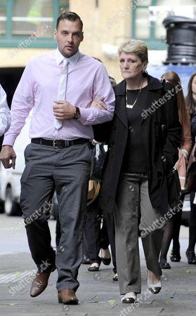 Ian Tomlinson's widow Julia and her son Paul King