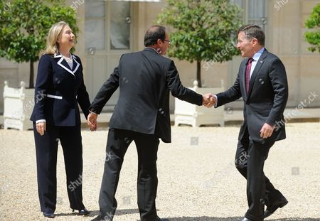US Secretary of State Hillary Clinton, French President Francois Hollande and Charles H. Rivkin at Elysee Palace