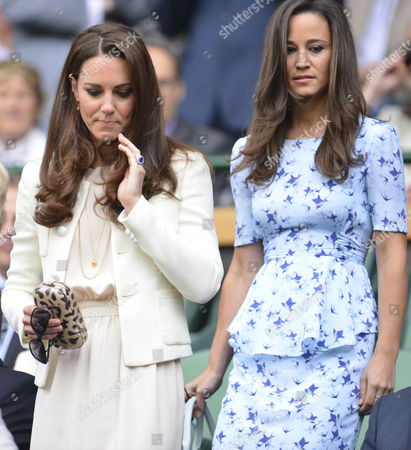 Catherine Duchess of Cambridge, left, and her sister Pippa Middleton arrive for the final