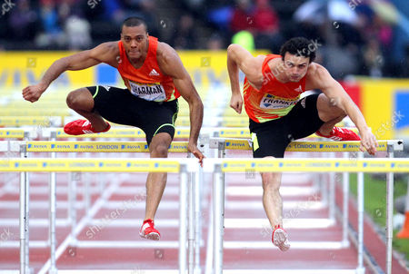 Gianni Frankis (R) & William Sharman (L) compete in the 110m Hurdles