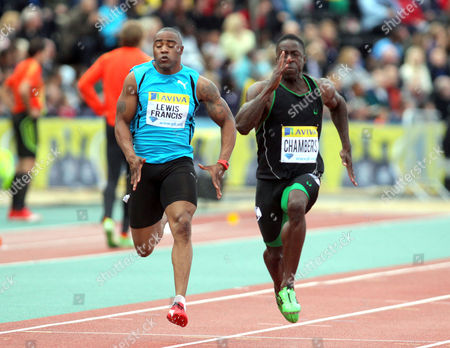 Mark Lewis-Francis (L) competes with Dwain Chambers (R) in the semi-final of the 100m