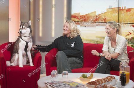 Emma Milne (rt) with Husky dog and a handler