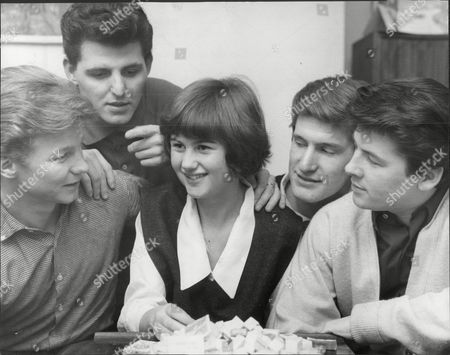 Stock Picture of Pop Group 'the Searchers' With 15-year-old Fan Gay Sheppard And Her Sugar Cube Collection. (l-r) John Mcnally Tony Jackson Gay Chris Curtis And Mike Pender.