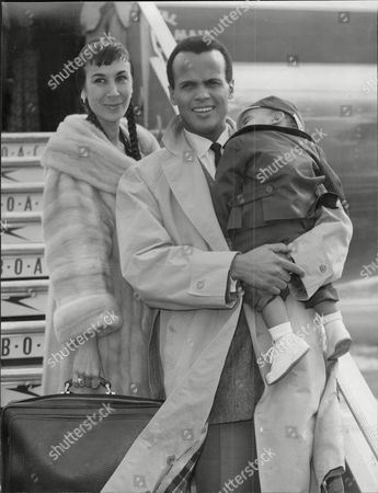 American Singer And Actor Harry Belafonte With Wife Julie And Son David Harold George 'harry' Belafonte Jr. (born March 1 1927) Is An American Singer Songwriter Actor And Social Activist. He Was Dubbed The 'king Of Calypso' For Popularizing The Caribbean Musical Style With An International Audience In The 1950s. Belafonte Is Perhaps Best Known For Singing 'the Banana Boat Song' With Its Signature Lyric 'day-o'. Throughout His Career He Has Been An Advocate For Civil Rights And Humanitarian Causes And Was A Vocal Critic Of The Policies Of The George W. Bush Administration.
