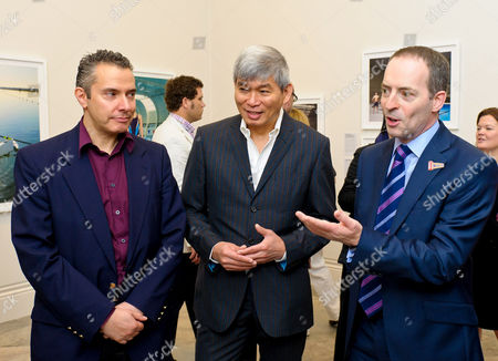 Jonathan Anderson and Edwin Low with Ian Livingston, CEO of BT