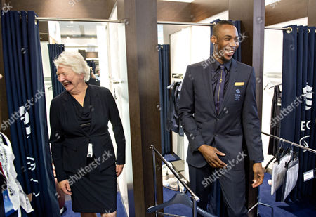 Phillips Idowu emerges from the changing room at the same time as Olympic gold medalist Mary Peters