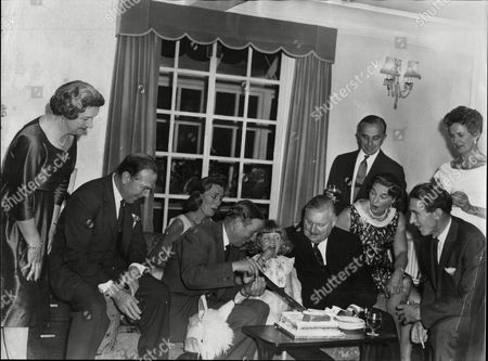 Katherine Douglas Daughter Of Lord Douglas Of Kirtleside Sits On Her Grandfather Surrounded By Prince Bernhard Lady Blandford Flo Desmond Aristottle Onassis John Cunningham And Sir Geoffrey De Havilland