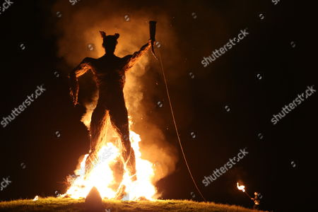 Kieren Webster, bassist of the View, helps to light the Wickerman at The Wickerman Festival