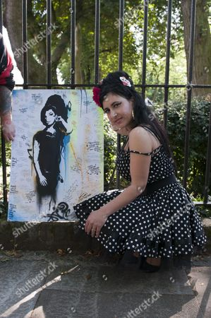Stock Picture of Cynthia Richter AKA Amy Margarida with artwork by Jason Haworth outside Amy Winehouse's home