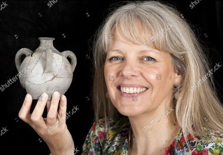 Sarah Morgan from the National Trust with the 'Stankpotten' or stink bomb