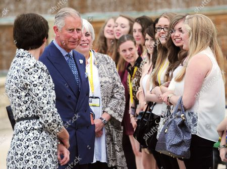 Prince Charles accompanied by the Duchess of Northumberland meets volunteers as they walk through Alnwick Gardens, Northumberland