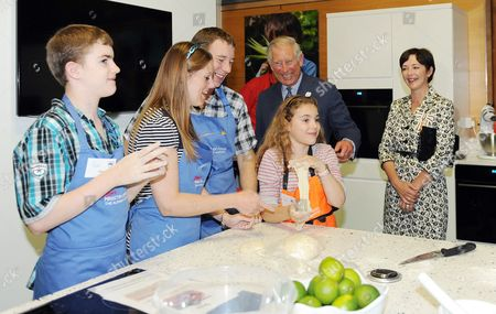 Prince Charles accompanied by the Duchess of Northumberland meet youngsters making dough as they open Jamie Oliver's Ministry of Food at Alnwick Gardens, Northumberland