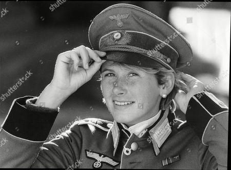 Noelle Anton Wearing A Peaked Cap That Belonged To Adolf Hitler. Part Of A World War Ii Memorabilia Sale By Phillips Auctioneers.