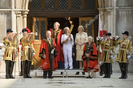 Lord Mayor of London David Wootton and torch bearer
