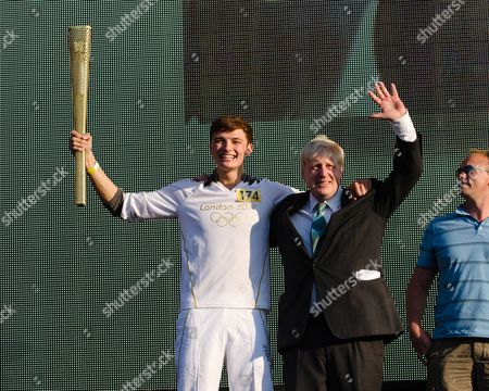 Stock Picture of Torch Bearer, Tyler Rix, comes onstage to meet the Mayor of London Boris Johnson