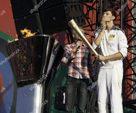 Torch Bearer, Tyler Rix, comes onstage to light the Olympic Cauldron