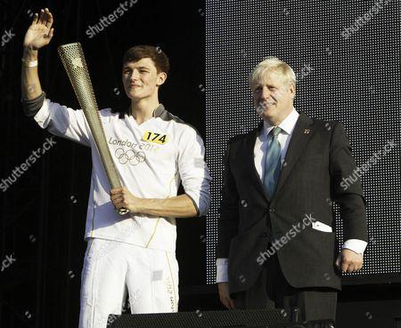 Torch Bearer, Tyler Rix, comes onstage to meet the Mayor of London Boris Johnson