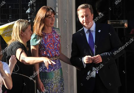 British Prime Minister David Cameron and wife Samantha Cameron with his Head of Operations Liz Sugg