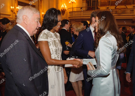 US Ambassador Louis B Susman and First Lady Michelle Obama meet the Catherine Duchess of Cambridge