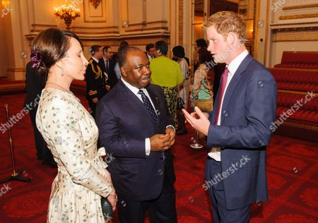 Prince Harry (R) with the President of Gabon Ali Bongo Ondimba and his wife Sylvia