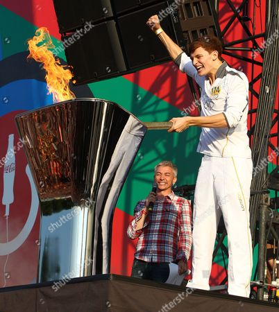Tyler Rix lights the Olympic cauldron with the Olympic Torch