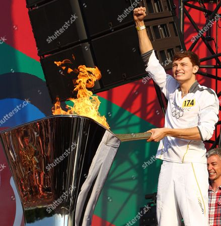 Stock Photo of Tyler Rix lights the Olympic cauldron with the Olympic Torch