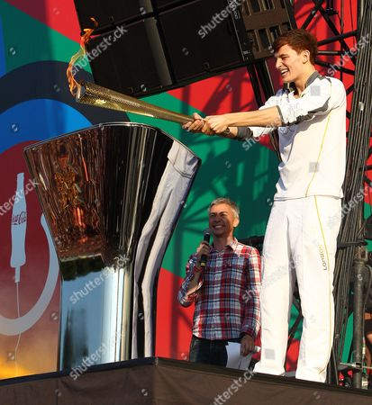 Stock Image of Tyler Rix lights the Olympic cauldron with the Olympic Torch