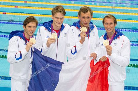 (L-R) Gold medallists Clement Lefert, Yannick Agnel, Amaury Leveaux and Fabien Gilot of France pose with their medals in the medal ceremony following the Men's 4x100m Freestyle Relay
