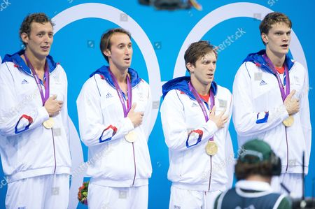 Gold medallists Clement Lefert, Yannick Agnel, Amaury Leveaux and Fabien Gilot of France with their medals in the medal ceremony following the Men's 4x100m Freestyle relay