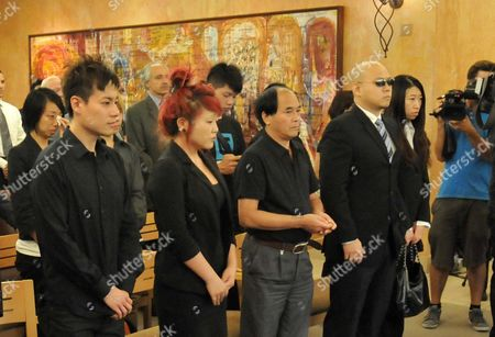 Mourners at Jun Lin's funeral