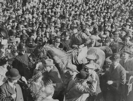 Horse Racing In Britain 1931 Grand National The Winner 'grakle' With Jockey R. Lyall In The Saddle Being Led To The Paddock The 1931 Grand National Was The 90th Renewal Of The World-famous Grand National Horse Race That Took Place At Aintree Racecourse Near Liverpool England In 1931. The Steeplechase Was Won By Grakle At Odds Of 100/6. The Nine-year-old Was Ridden By Jockey Bob Lyall And Trained By Tom Coulthwaite For Owner Cecil Taylor Who Collected The A9 310 Prize. Gregalach Winner In 1929 Finished In Second Place; Annandale Was Third And Rhyticere Fourth. Forty-three Horses Ran And All But Two Returned Safely To The Stables. Swift Roland Was Fatally Injured At Becher's Brook When Another Faller Landed On Him And Drin Was Euthanised After Incurring A Leg Fracture At Valentine's Brook.
