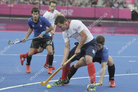 Men's Hockey - Team GB vs. Argentina at the Riverbank Arena. James Tindall of Team GB
