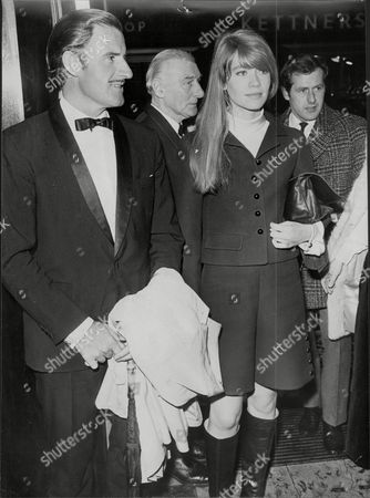 Racing Driver Graham Hill (dead Novemeber 1975)with Singer Francoise Hardy At The Premiere Of The Film Grand Prix
