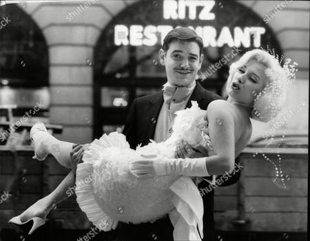 Fashion Women Underwear Look-a-likes Kay Kent (marilyn Monroe) And Bob Valentino (clark Gable) At He Ritz In London Posing For Fashion Shot