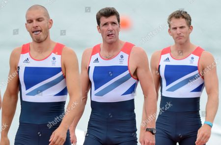 Stock Photo of Greg Searle of Great Britain walks between team-mates Mohamed Sbihi (left) and Matthew Langridge (right) as they walk to collect their bronze medals for the Rowing Men's Eight