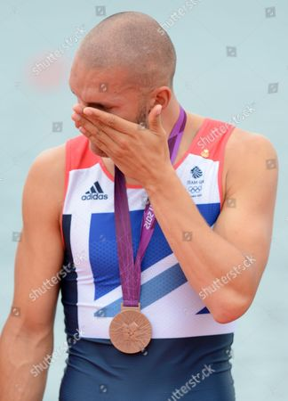 A dejected Mohamed Sbihi after receiving his bronze medal for the Rowing Men's Eight