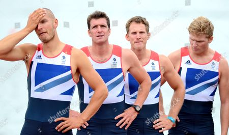 Great Britain's mens Eight crew of Mohammed Sbihi, Greg Searle, Matthew Langridge and Constantine Louloudis await to be presented with their bronze medal