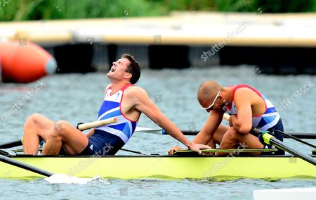 Greg Searle and Mohammed Sbihi of Great Britain's mens Eight crew look exhausted after the race in which they claimed bronze