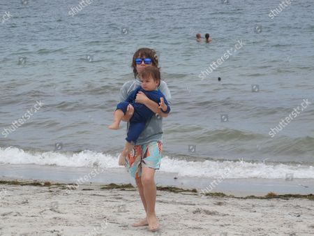 Editorial image of Luciana Morad with sons Lorenzo Gabriel and Lucas Jagger at Miami Beach, Florida, America  - Jul 2012