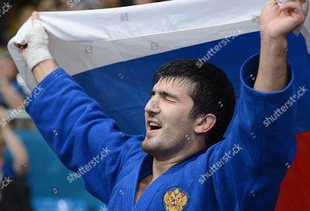 Tagir Khaibulaev of Russia celebrates winning a Gold medal - 100kg category