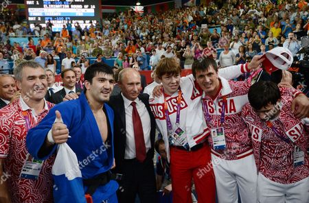 Vladimir Putin, President of Russia with Gold medallist in the Judo 100kg category Tagir Khaibulaev of Russia