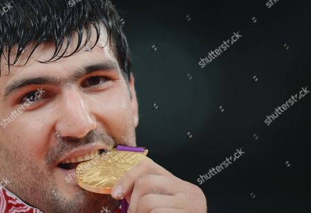 Tagir Khaibulaev of Russia celebrates with his Gold medal in the Men's Judo 100kg category