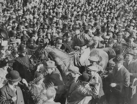 Horse Racing In Britain 1931 Grand National The Winner 'grakle' With Jockey R. Lyall In The Saddle Being Led To The Paddock The 1931 Grand National Was The 90th Renewal Of The World-famous Grand National Horse Race That Took Place At Aintree Racecourse Near Liverpool England In 1931. The Steeplechase Was Won By Grakle At Odds Of 100/6. The Nine-year-old Was Ridden By Jockey Bob Lyall And Trained By Tom Coulthwaite For Owner Cecil Taylor Who Collected The A9 310 Prize. Gregalach Winner In 1929 Finished In Second Place; Annandale Was Third And Rhyticere Fourth. Forty-three Horses Ran And All But Two Returned Safely To The Stables. Swift Roland Was Fatally Injured At Becher's Brook When Another Faller Landed On Him And Drin Was Euthanised After Incurring A Leg Fracture At Valentine's Brook..