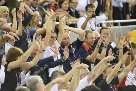 David Hemery, Catherine Duchess of Cambridge, Prince William and Prime Minister David Cameron doing a Mexican Wave during a lull in the track cycling in the velodrome