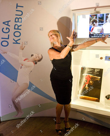 Olga Korbut with a photograph of herself
