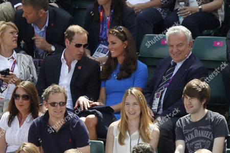 Prince William, Catherine Duchess of Cambridge and Francesco Ricci Bitti, President of the International Tennis Federation, watch the Men's Singles at Wimbledon