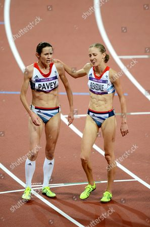 Julia Bleasdale and Joanne Pavey of Great Britain react after competing in the Women's 10,000m