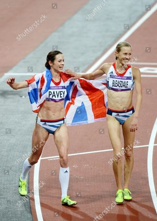 Julia Bleasdale and Joanne Pavey of Great Britain do a lap of honour after competing in the Women's 10,000m