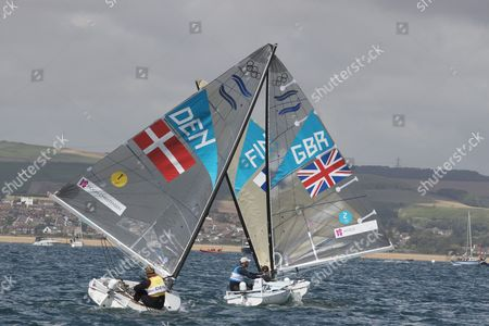 Ben Ainslie leading rival Jonas-Hogh-Christensen to the finish in the Finn class