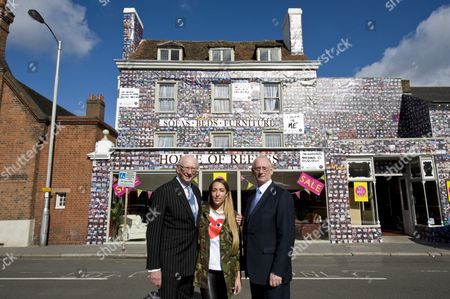 Delilah, Maurice Reeves and Trevor Reeves the co-owners of House of Reeves, outside their temporary store, Croydon
